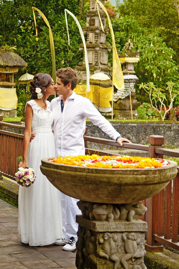 Couple in white celebrating a wedding in Bali, Indonesia