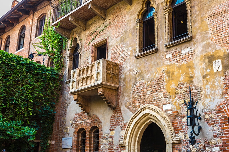Juliet's balcony in Verona, Italy during a romantic honeymoon trip in Italy