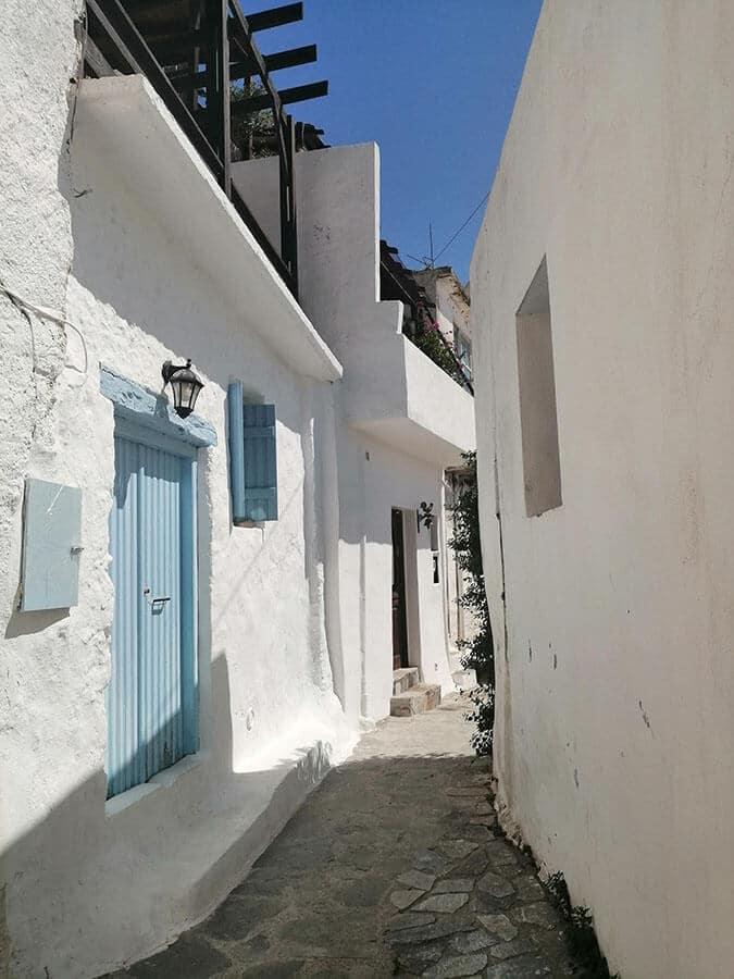Beautiful white walls and blue doors in Mirthios, a charming village near Plakia, Crete, Greece.