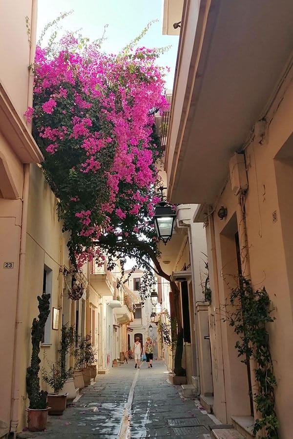 Beautiful alleyway in Rethymno, Crete with blooming flowers.