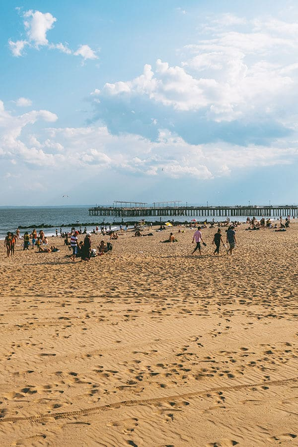 New Yorkers enjoying the beach on Coney Island, Brooklyn, New York