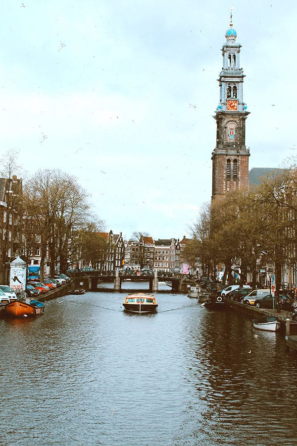 Westerkerk church in Amsterdam with views of a canal cruise in Amsterdam