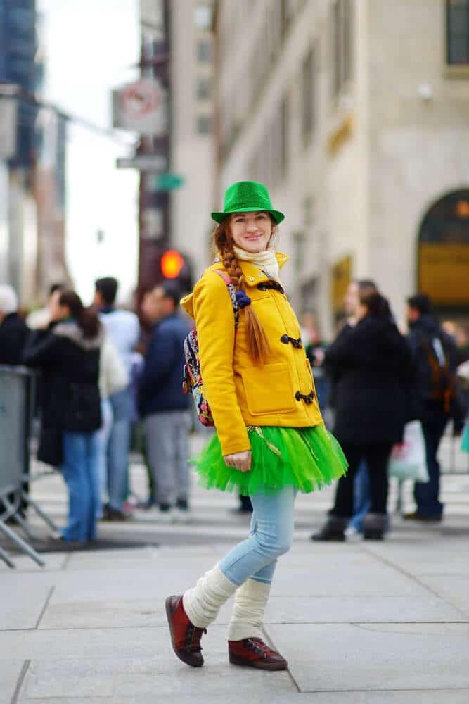 Girl enjoying St. Patrick's Day Parade in New York City dressed in green tutu!