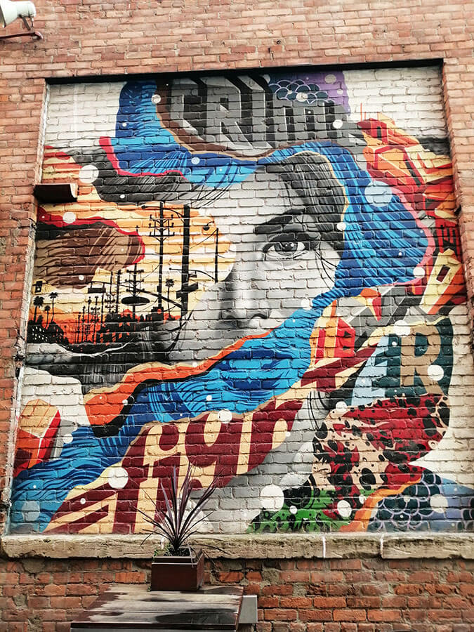 Beautiful street art of a woman seen within the Belt of Detroit, a cool street with street art