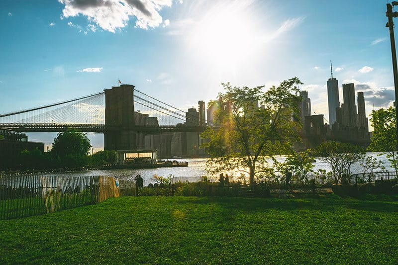 Sunset at Brooklyn Bridge Park with a view of Brooklyn Bridge, one of the best cheap things to do in New York City.